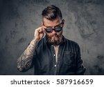 studio portrait of a bearded... | Shutterstock . vector #587916659