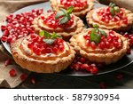 tasty tarts with fresh seeds of ... | Shutterstock . vector #587930954