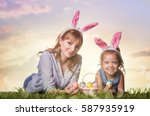 mother and daughter with easter ... | Shutterstock . vector #587935919