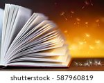 pages of an open magic book... | Shutterstock . vector #587960819