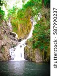 waterfall with the green plan... | Shutterstock . vector #587990237