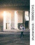 young man running in urban... | Shutterstock . vector #588001541