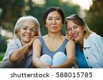 three mature ladies smiling  | Shutterstock . vector #588015785