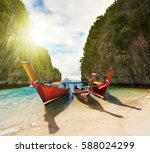 boats on the beach inside small ... | Shutterstock . vector #588024299