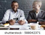 successful happy african... | Shutterstock . vector #588042371