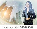 businesswoman using a mobile... | Shutterstock . vector #588045344
