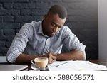 hardworking young african... | Shutterstock . vector #588058571