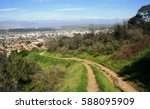 trail leading down a hill side... | Shutterstock . vector #588095909