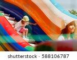 two little girls in sun panama... | Shutterstock . vector #588106787