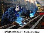 welders working at the factory... | Shutterstock . vector #588108569