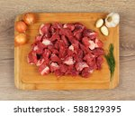 raw veal meat cubes on the... | Shutterstock . vector #588129395