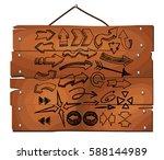 arrows set on wooden plank... | Shutterstock .eps vector #588144989