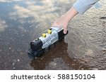 child's hand and toy train in...   Shutterstock . vector #588150104