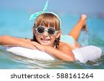 cute little girl is swimming in ...   Shutterstock . vector #588161264