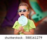 cute little girl with lollipop | Shutterstock . vector #588161279