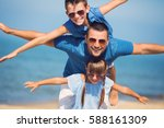 father with children having fun.... | Shutterstock . vector #588161309