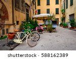 old cozy street in lucca  italy.... | Shutterstock . vector #588162389