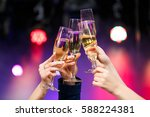 clinking glasses of champagne... | Shutterstock . vector #588224381