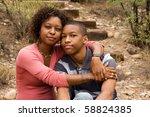 loving single mother hugging...   Shutterstock . vector #58824385