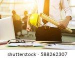 engineer hold security helmet... | Shutterstock . vector #588262307