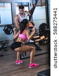 fitness couple exercising in... | Shutterstock . vector #588275441