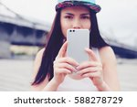 cute young girl taking picture... | Shutterstock . vector #588278729