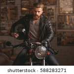 handsome bearded man in leather ... | Shutterstock . vector #588283271