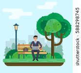 man works in park with computer ... | Shutterstock .eps vector #588298745