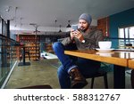 young handsome hipster guy with ... | Shutterstock . vector #588312767