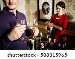happy man tasting wine   Shutterstock . vector #588315965