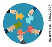hands put five jigsaw puzzle... | Shutterstock .eps vector #588317807