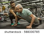 keep pushing  full length shot... | Shutterstock . vector #588330785