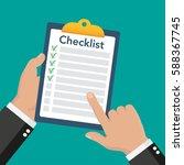 hand holding clipboard... | Shutterstock .eps vector #588367745