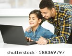 study online. cheerful young... | Shutterstock . vector #588369797