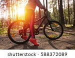 woman riding a mountain bicycle ... | Shutterstock . vector #588372089