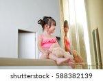 portrait of asian child girl in ... | Shutterstock . vector #588382139