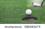 golf ball dropping into the...   Shutterstock . vector #588383675