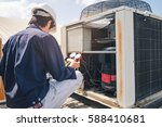 Small photo of Technician is checking air conditioner