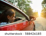happy smiling woman in a car... | Shutterstock . vector #588426185