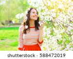 happy smiling young woman with... | Shutterstock . vector #588472019