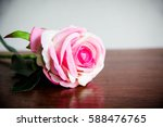 pink rose on wood table love...   Shutterstock . vector #588476765