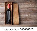 red wine bottle in box in front ...   Shutterstock . vector #588484529
