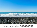 waves breaking on a stony beach ... | Shutterstock . vector #588490559