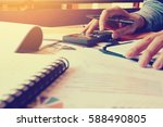woman using calculator and... | Shutterstock . vector #588490805