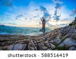 The Woman Practices Yoga At...