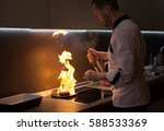chef cooking with flame on his... | Shutterstock . vector #588533369