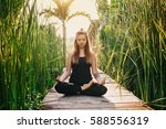 young woman practicing yoga... | Shutterstock . vector #588556319