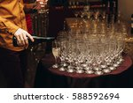Elegant Waiter Pouring Sparkly...