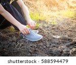 woman wear sport shoe doing... | Shutterstock . vector #588594479