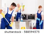 focused co workers are cleaning ... | Shutterstock . vector #588594575